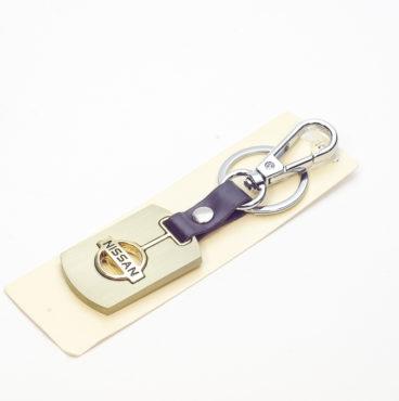 Брелок 003 на ключ металлический ЗОЛОТО на кожаной подвеске с объёмным логотипом NISSAN (0765)