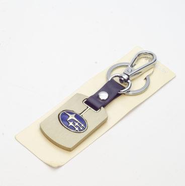 Брелок 005 на ключ металлический ЗОЛОТО на кожаной подвеске с объёмным логотипом SUBARU (0895)