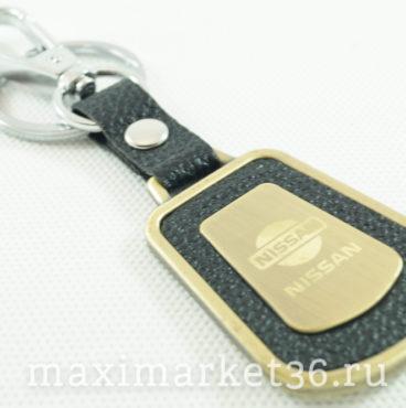 Брелок на ключ металлический с кожаной вставкой и логотипом авто NISSAN